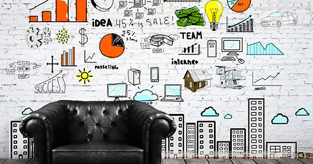 Informative white wall in the office filled with icons for creativity and ideas