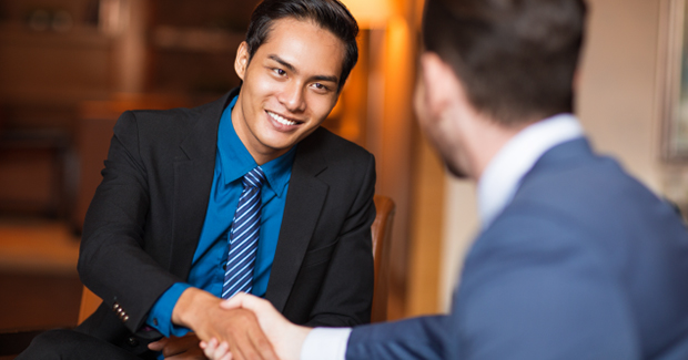 Employee shakes hands with his boss to celebrate the promotion